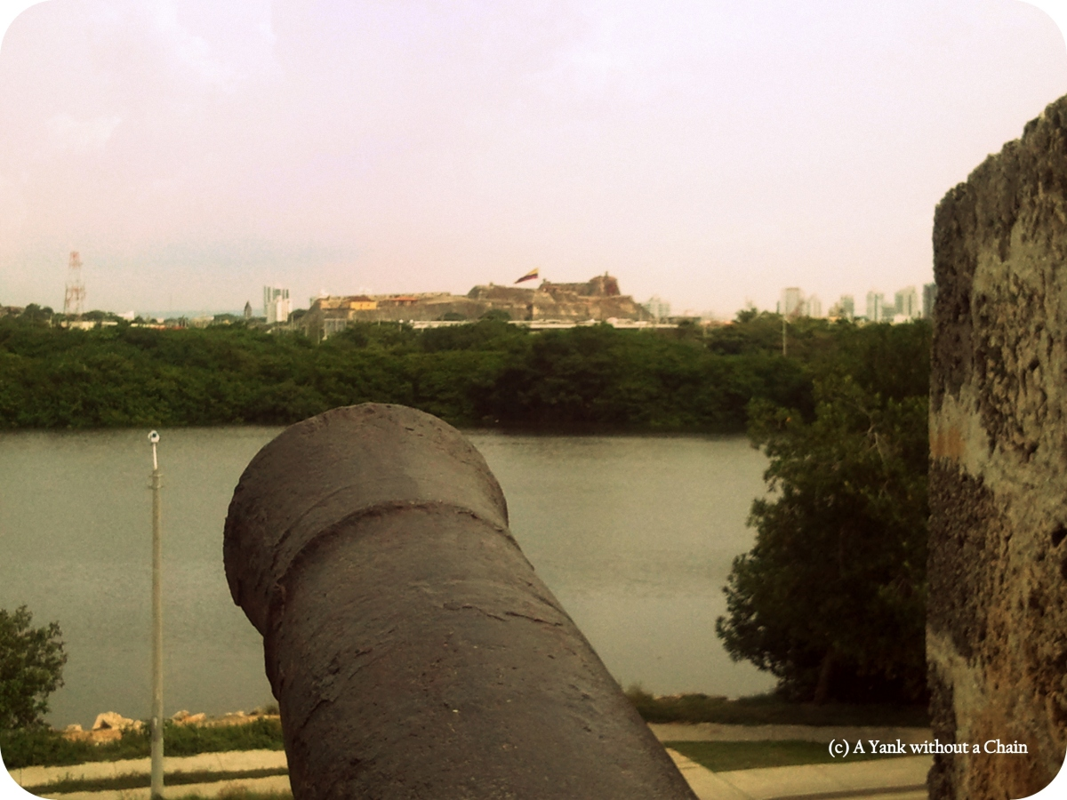 A cannon and the Castillo de San Felipe