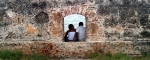 Lovers sitting in Cartagena's wall