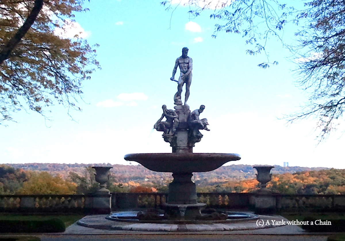 The Fountain of Oceanus at the front of the Rockefeller Estate, with a view of the foliage in Hudson Valley behind it.