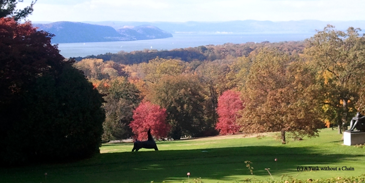 The Rockefeller's private golf course with a view of fall foliage and the Hudson River