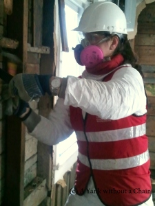 The Yank without a Chain tearing down a mold-infested wall in the Rockaways