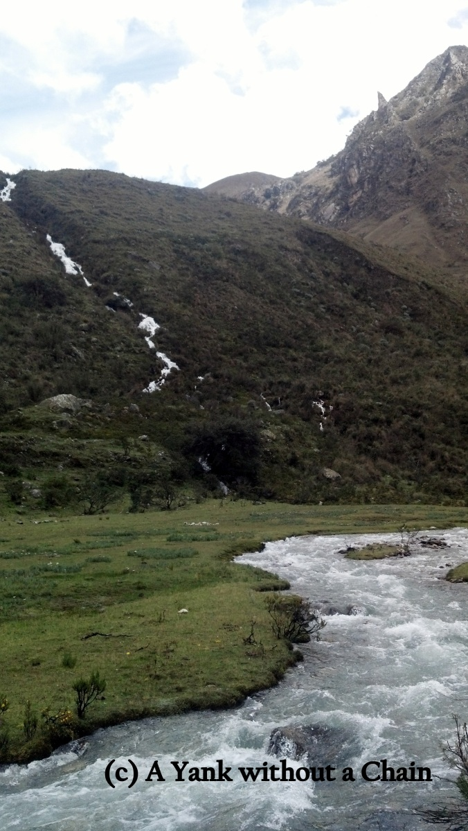 The hike began with a long walk along a winding river in a valley