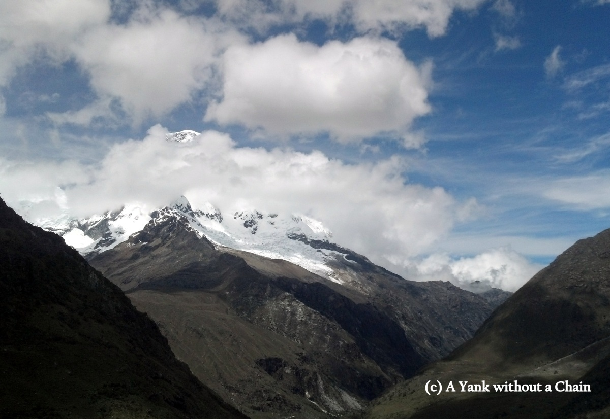Peaking up out of the clouds is Huascaran, the highest mountain in Peru