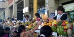 A row of juice ladies serving customers