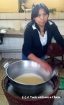 A woman making the traditional queso helado at San Camilo Market