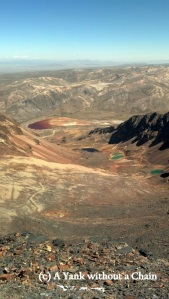 A view of the colorful mineral lakes from Chacaltaya