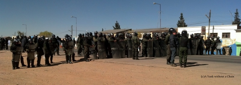 Police officers prepare to handle the miner's protest outside Oruro