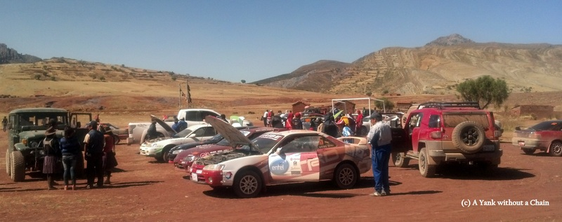 Drivers work on their cars at the conclusion of the nearly 100 km Maragua race
