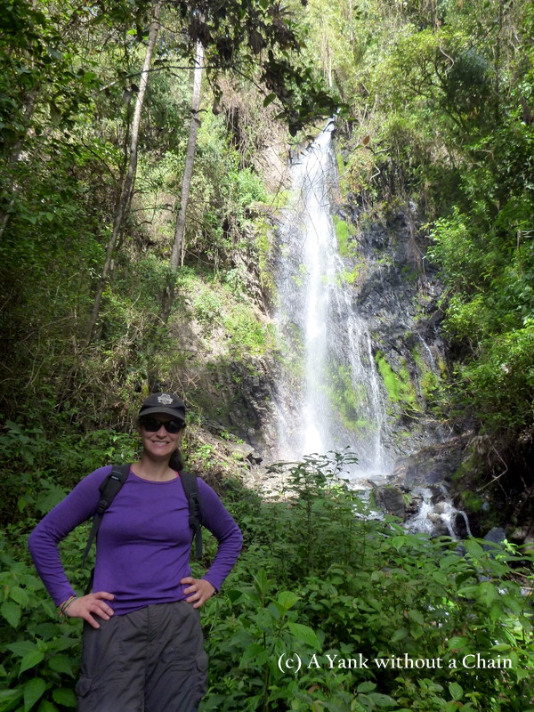 Standing in front of a waterfall, just a short hike from the village of Suri