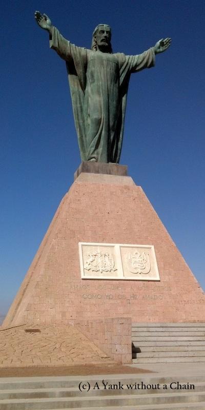 A statue of Jesus on top of the Morro de Arica