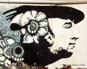 A portrait of Neruda on a wall outside his Santiago home