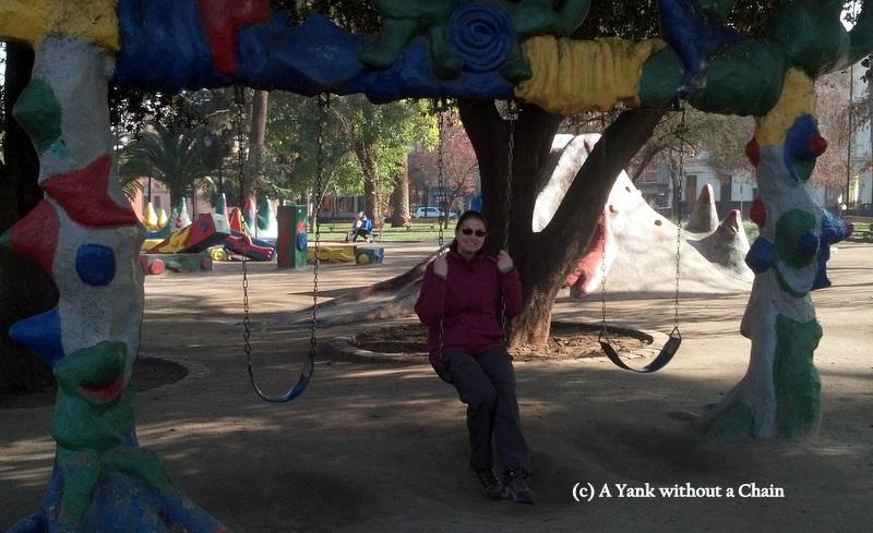 Sitting on a swingset in Plaza Brasil