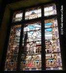 A stained glass inside the city hall representing -- the city hall