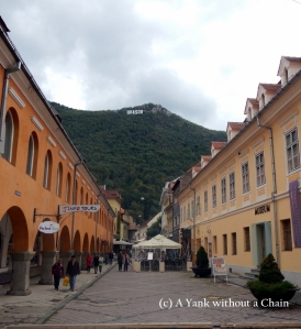 A street in Brasov with the Hollywood-like sign in the background