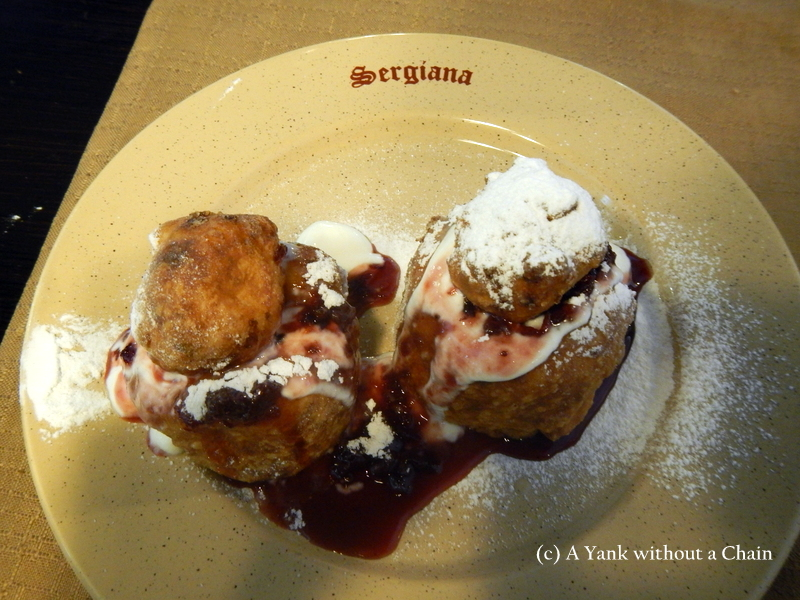 """Papanasi, the """"must eat"""" dish in Romania - a type of donut filled with sweet cheese and jam."""
