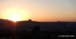The sun setting behind Uchisar Castle