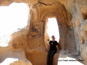 Sitting in a window in the Selime Monastery in Cappadocia