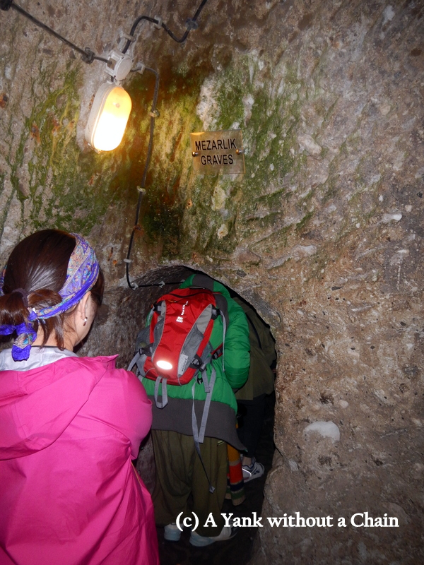 Following a tunnel to see the gravesites in Derinkuyu