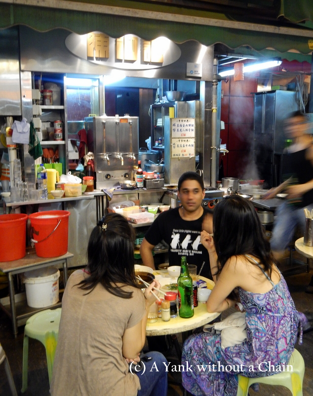 Sitting at a street food stall in central Hong Kong