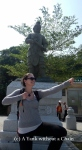 Posing with an archer statue at the Big Buddha site