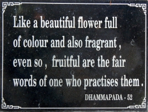 A plaque with a quote from the Dhammapada at Long Son Pagoda