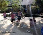 Local girls playing a double dutch-like game