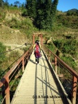 Our guide, Gom, walking across a bridge