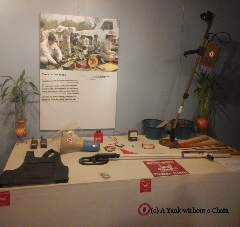 A display showing how volunteers are cleaning up the UXOs and educating people about them