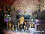 A sleeping Buddha statue at Vat Xieng Thong in Luang Prabang