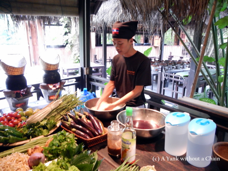 The cooking instructor demonstrating how to clean sticky rice