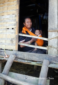 A woman and her grandson at Ban Houay Thong Village