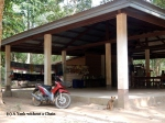 A dog and a motorbike outside a hut on the far side of Kong Lor cave
