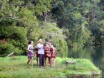 A photographer showing his subjects his latest snap at Yeak Laom lake