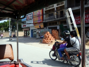 A dubious way to transport a ladder in Phnom Penh