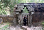 The Yank without a Chain inside a doorway at the Royal Palace within Angkor Thom