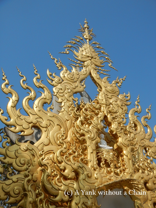 A Buddha figure that is a part of the White Temple complex near Chiang Rai, Thailand