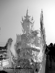 A figure outside the White Temple in Chiang Rai