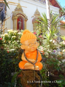 A baby monk statue at Wat Phra That Doi Suthep