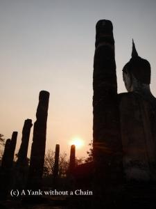 A Buddha statue at Sunrise at Wat Mahathat at Sukothai Historical Park