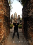 Standing at the entrance of Wat Si Sawai at Sukothai Historical Park