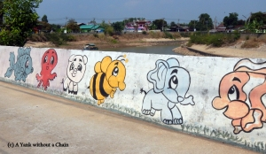 Some baby animals adorning a wall along the river in New Sukhothai