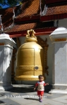 A baby and a bell at Wat Phra That Doi Suthep