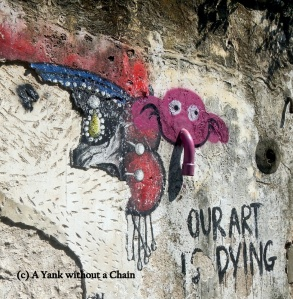 A pink elephant and a cynical message on a wall near Lebuh Armenian in George Town, Penang