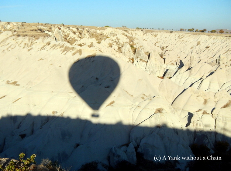 The silhouette of my hot air balloon on the cliffs of Cappadocia