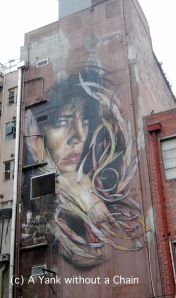 A gigantic mural by Adnate that rises above Tattersall's Lane in Melbourne's CBD