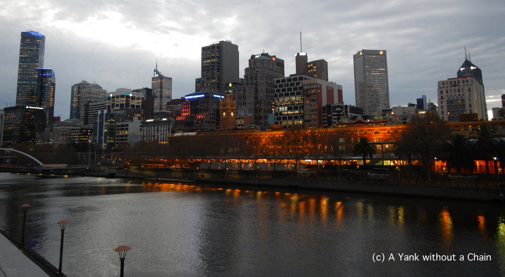 The lights of Flinders Street Station reflecting off the Yarra River