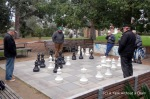 Men playing a gigantic game of chess at the St. Kilda Botanic Gardens