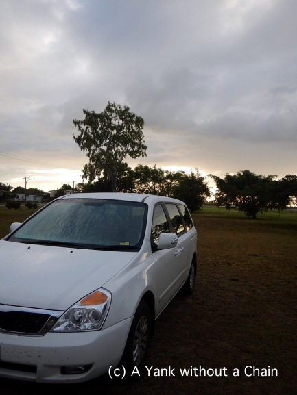 My car in the rest area at Home Hill, waking up with the sun