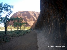 You can get a sense of how huge Uluru is by how tiny the women walking appear