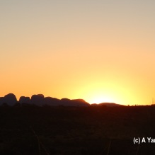 The sun setting over Kata Tjuta, Uluru's sister site